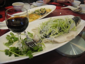 steamed bass (with the soy sauce in the wine glass)