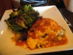 Vegetarian Moussaka -- Casserole of zucchini, eggplant, spinach, sweet peppers, and potato topped with béchamel, served with baby greens