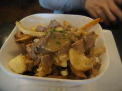 DDD Poutine au Canard off-the-bone duck confit & québécois cheese curds, frites, demi-glace gravy