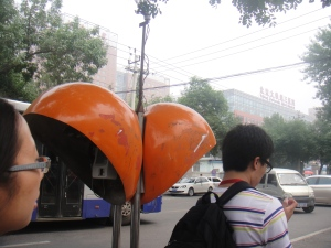 These are what the telephone booths in Beijing look like. Looks like orange pods lol
